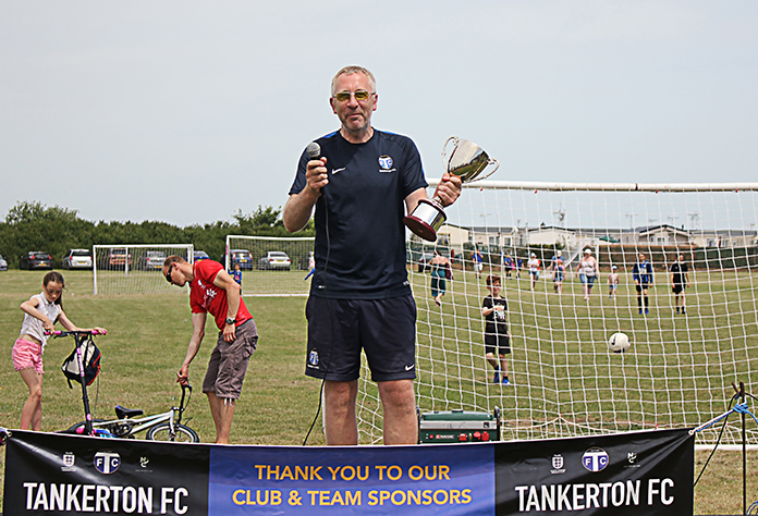 Under 10s' coach, Jamie Clark with the TFC Manager of the Season Trophy