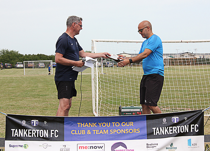 TFC Chairman, Andy Davidson presents the Chairman's Special Award to Dean Gonsalves